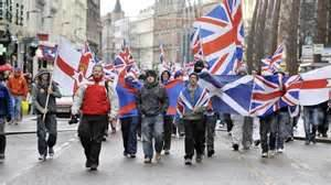 Loyalists show their allegiances- Union Jack, Red Hand of Ulster and the Saltire