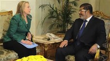 Moslem Brotherhood President Mursi of Egypt meets Hilary Clinton, US Secretary of State