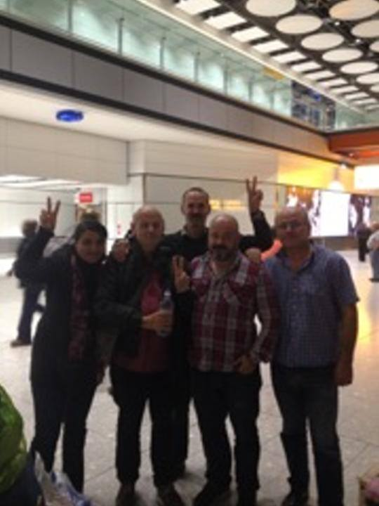 Steve Kaczynski (second from left) arriving back at Heathrow Airport